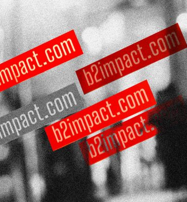 Mehrere b2impact.com Sticker auf einer Scheibe